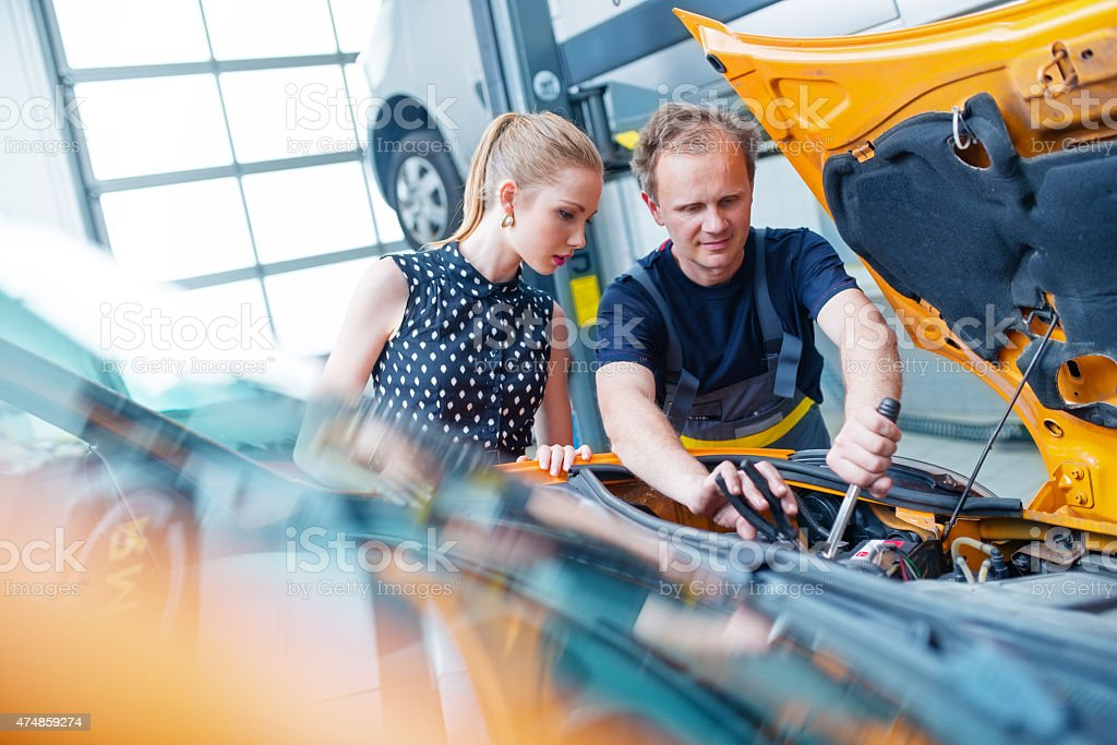 Auto Mechanic with Female Customer stock photo