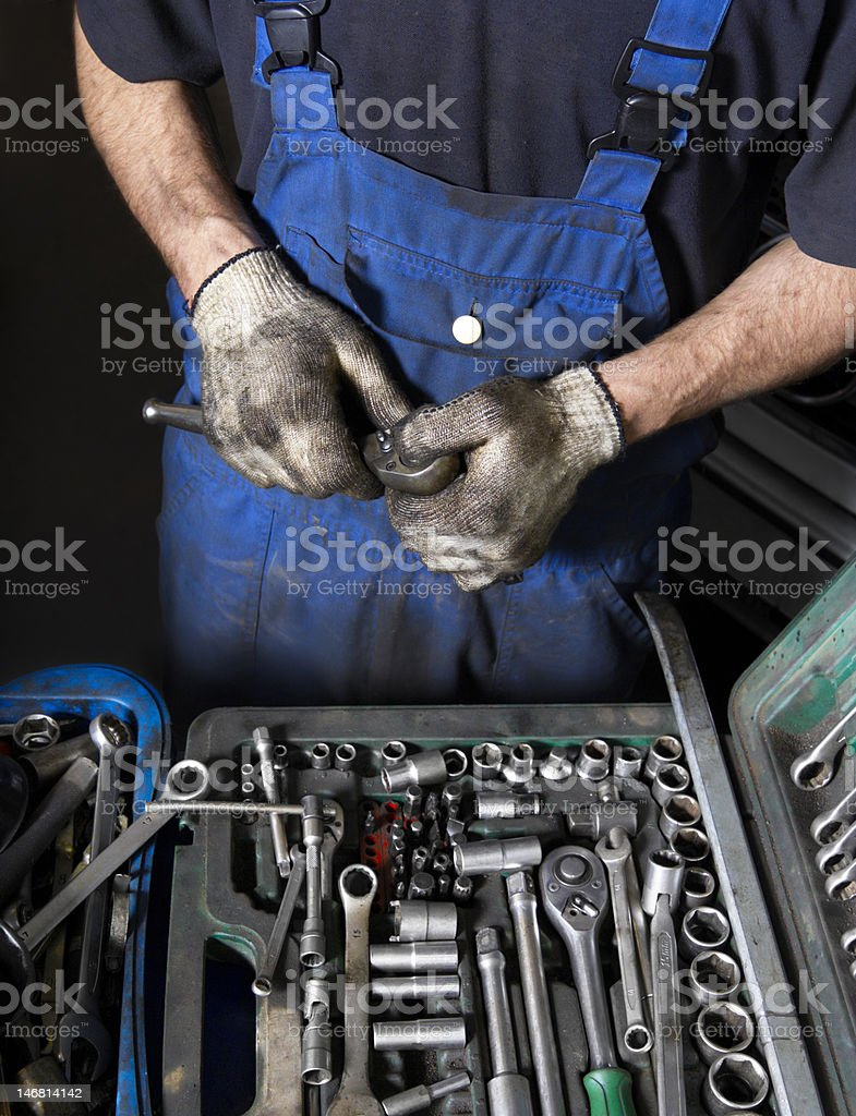 Auto mechanic with working tools royalty-free stock photo