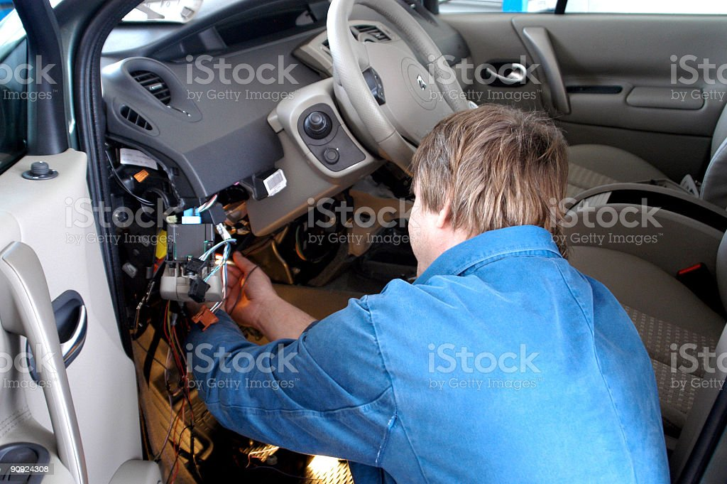 Auto mechanic working - Car electric repair stock photo