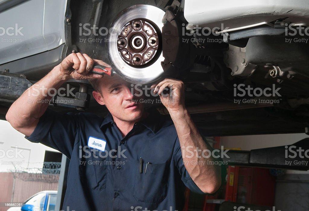 Auto Mechanic Working on Car stock photo
