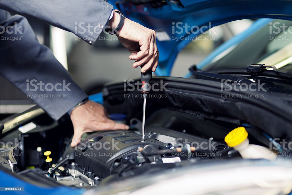 Auto mechanic working on the engine stock photo