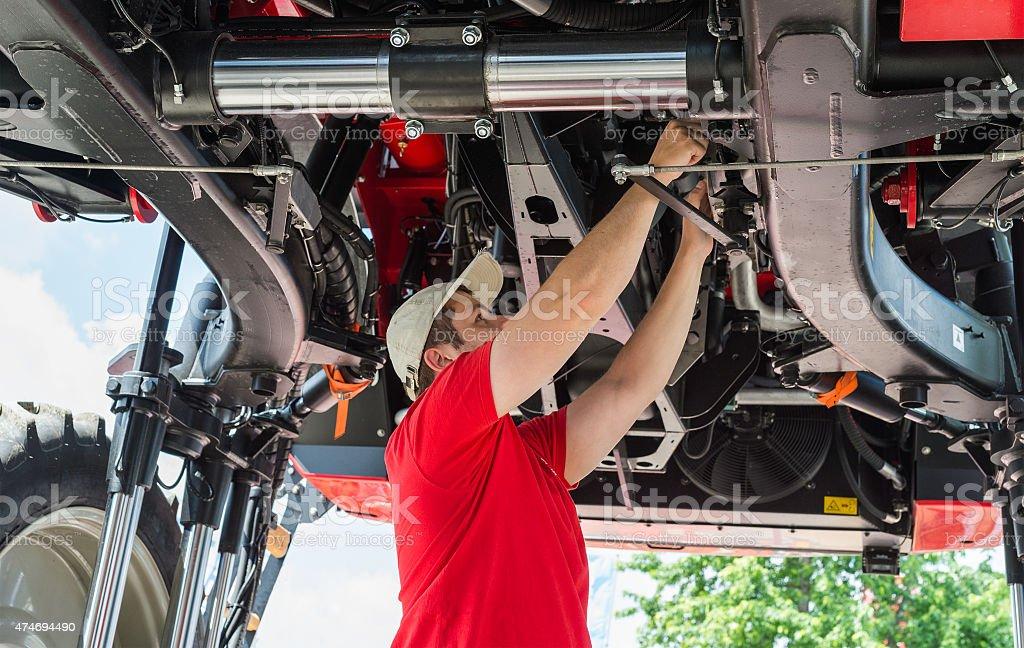 Auto mechanic working stock photo