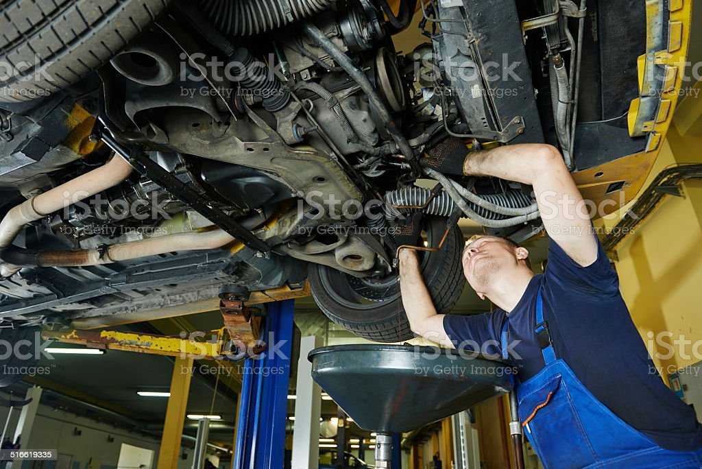 auto mechanic working stock photo