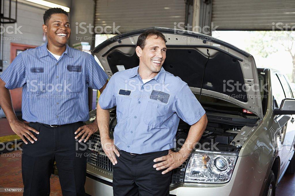 Auto mechanics in garage royalty-free stock photo