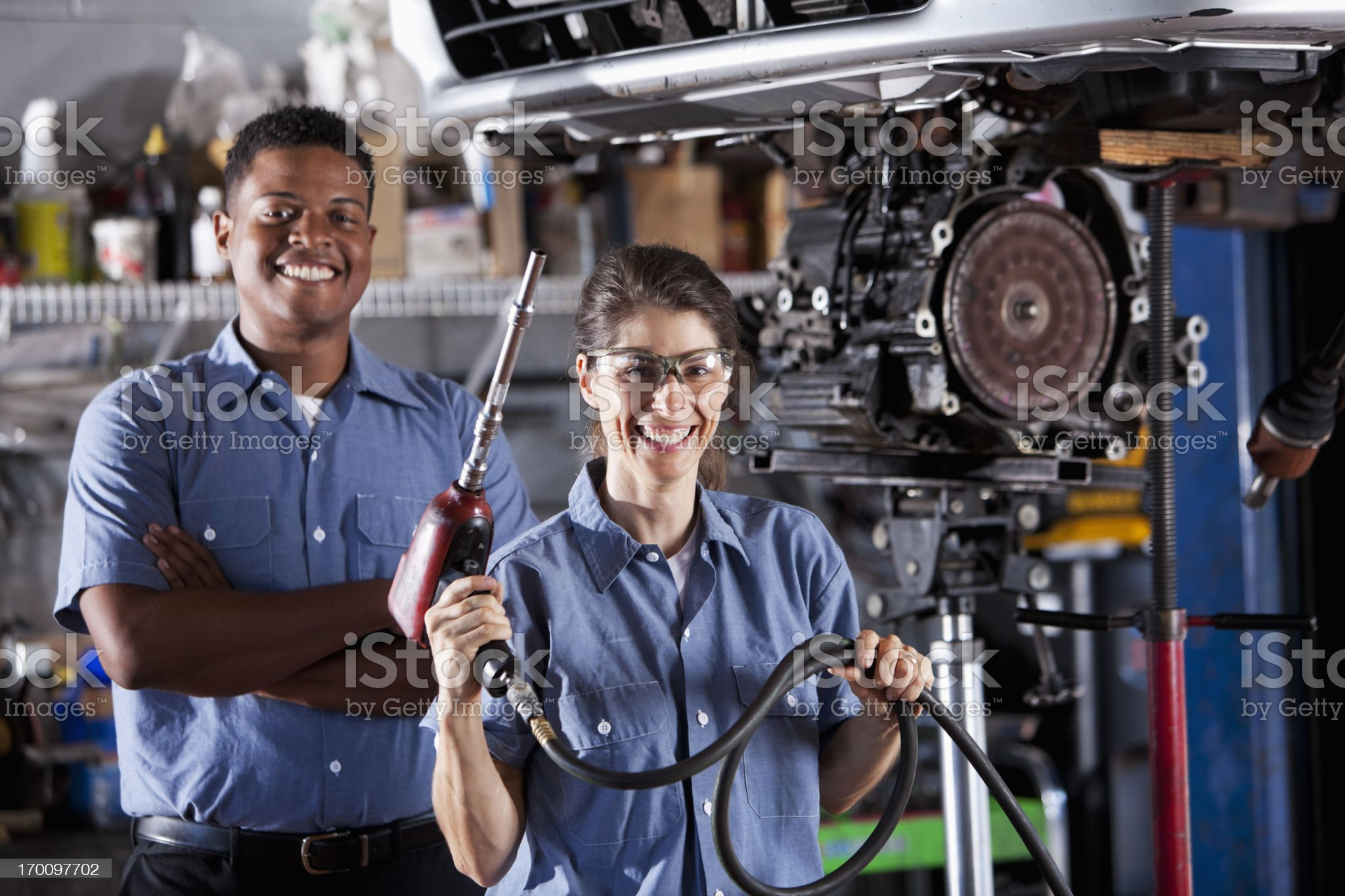 Auto mechanics working on car transmission royalty-free stock photo
