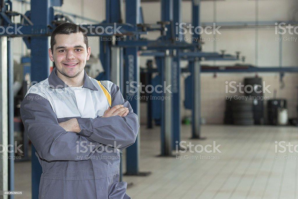 Auto repair service. Handsome smiling mechanic. stock photo