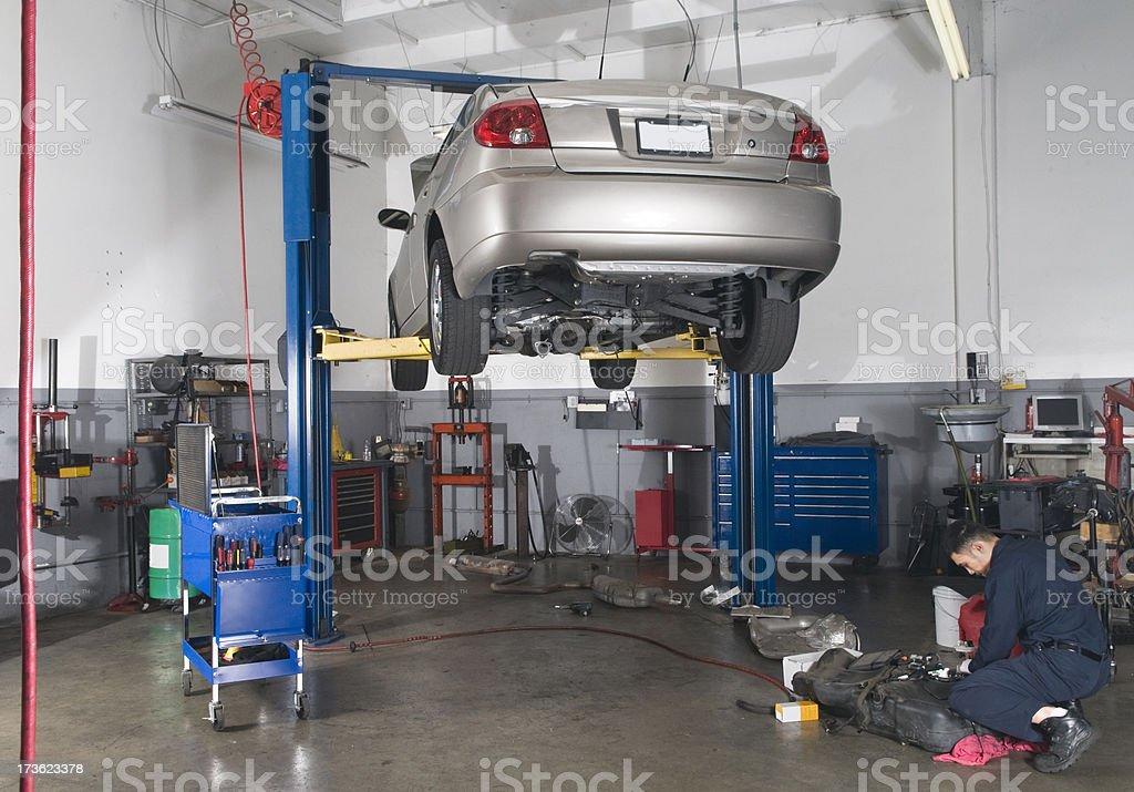 Auto Repair Shop - Car On Lift royalty-free stock photo