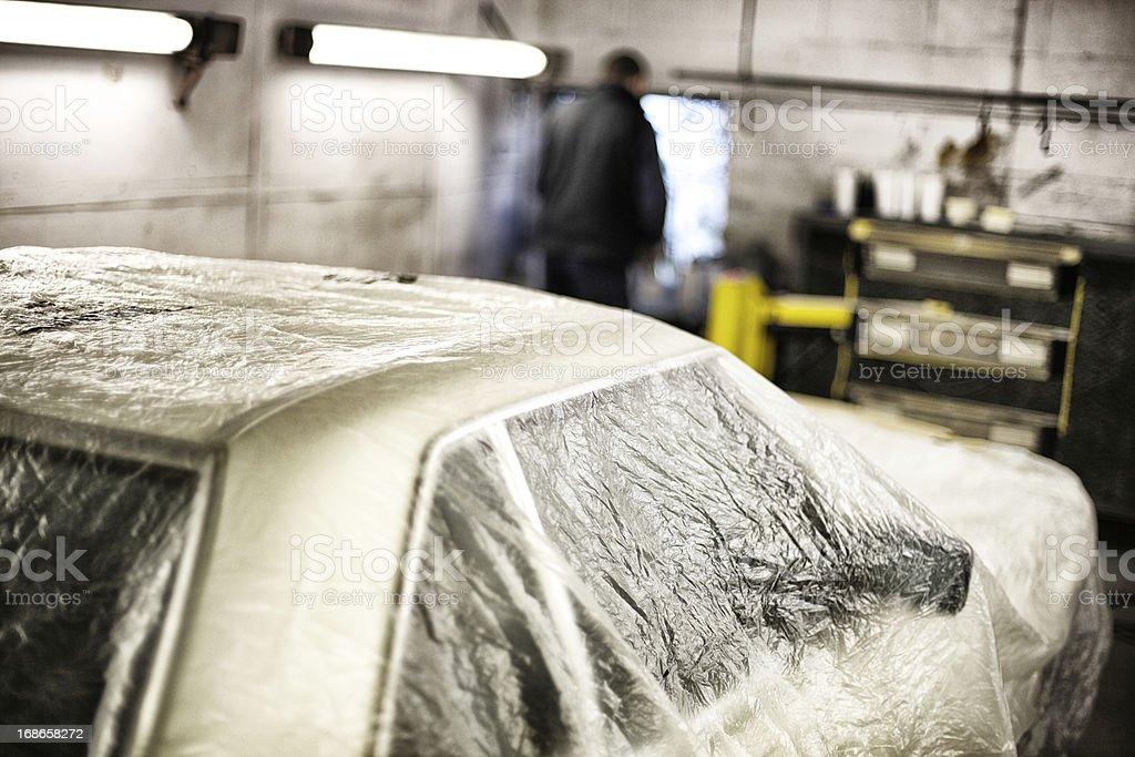 Auto repair shop, plastic dust sheeting royalty-free stock photo