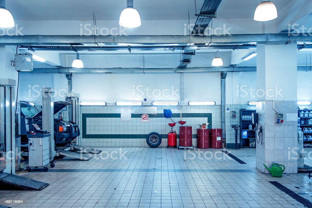 Auto Repair Shop with Mechanic in Background stock photo