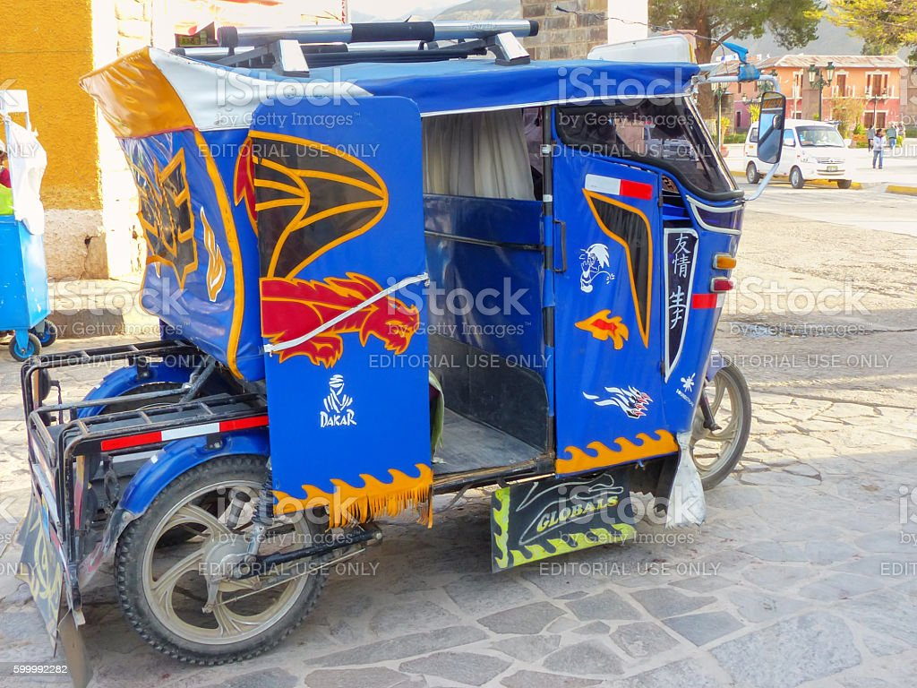 Auto rickshaw parked in the street of Chivay town, Peru stock photo