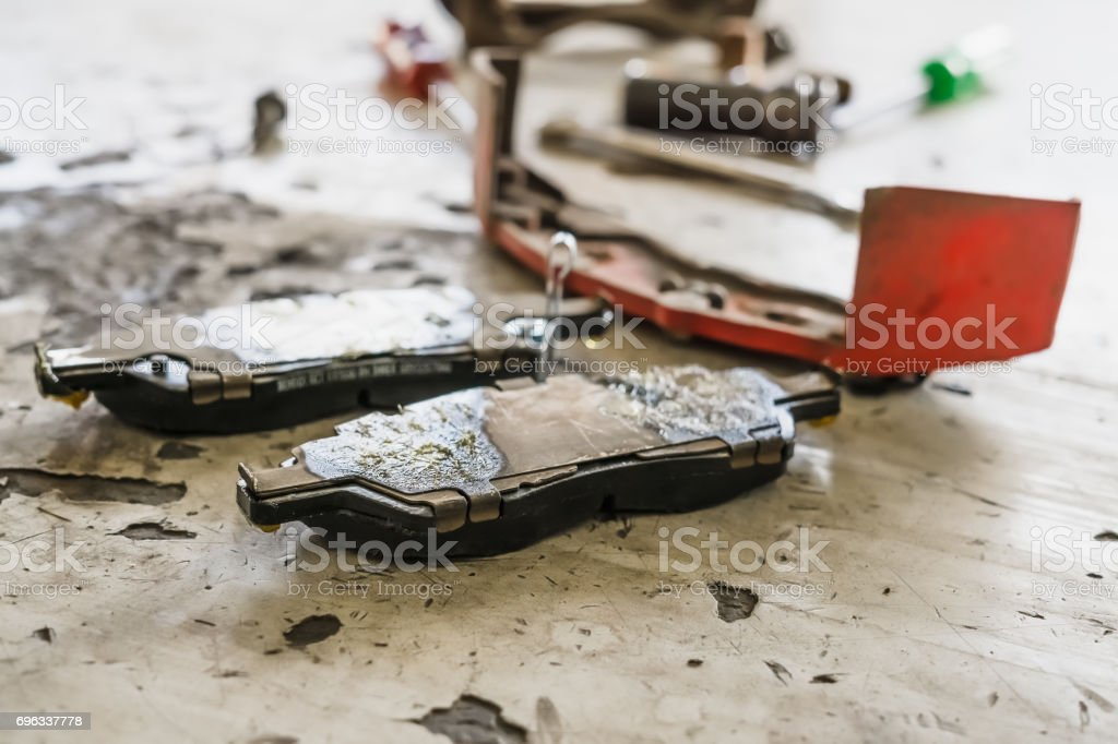 Auto Service, car disc brakes pad changing, selective focus stock photo