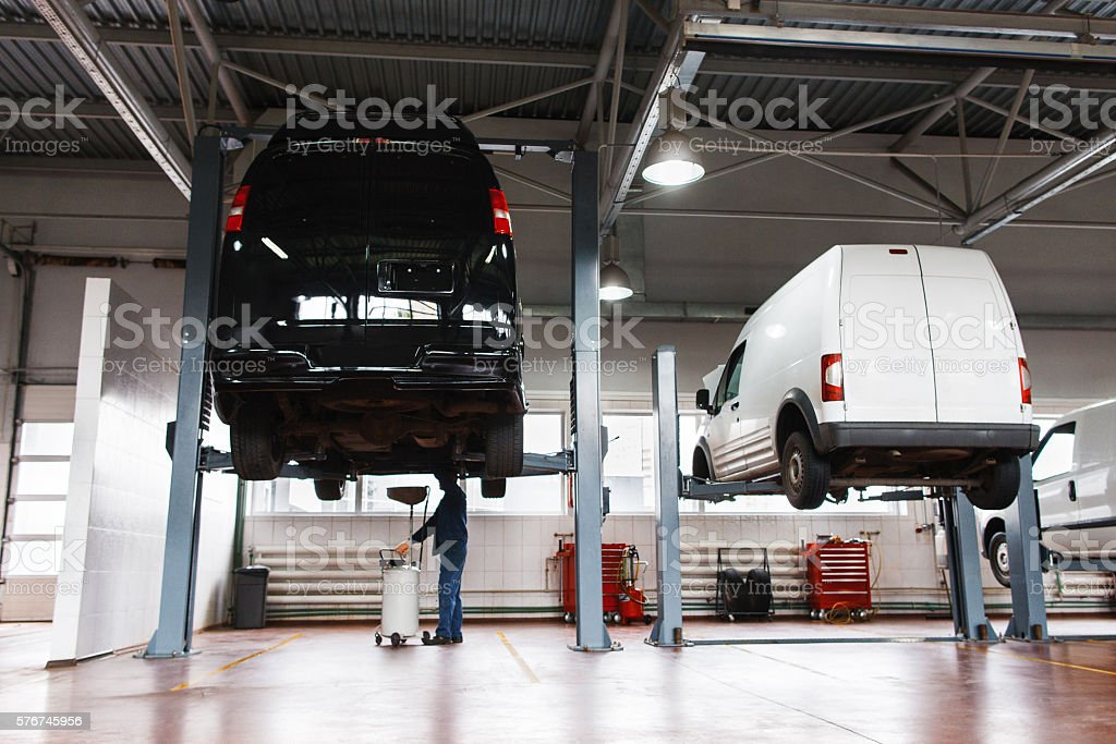 Auto service maintenance for minibuses, workshop stock photo