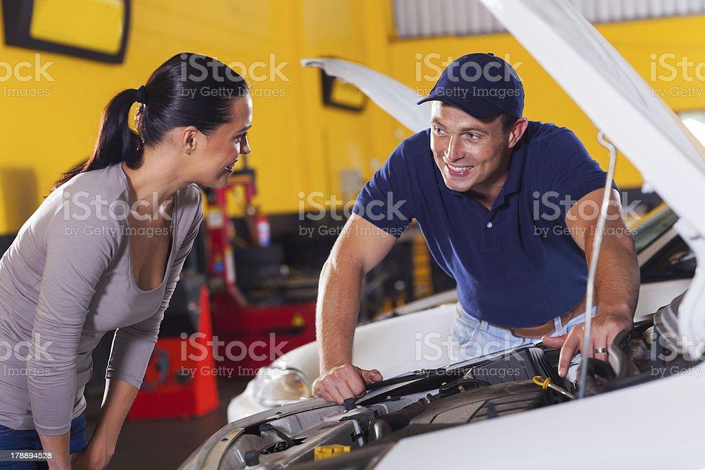 auto technician talking to customer stock photo