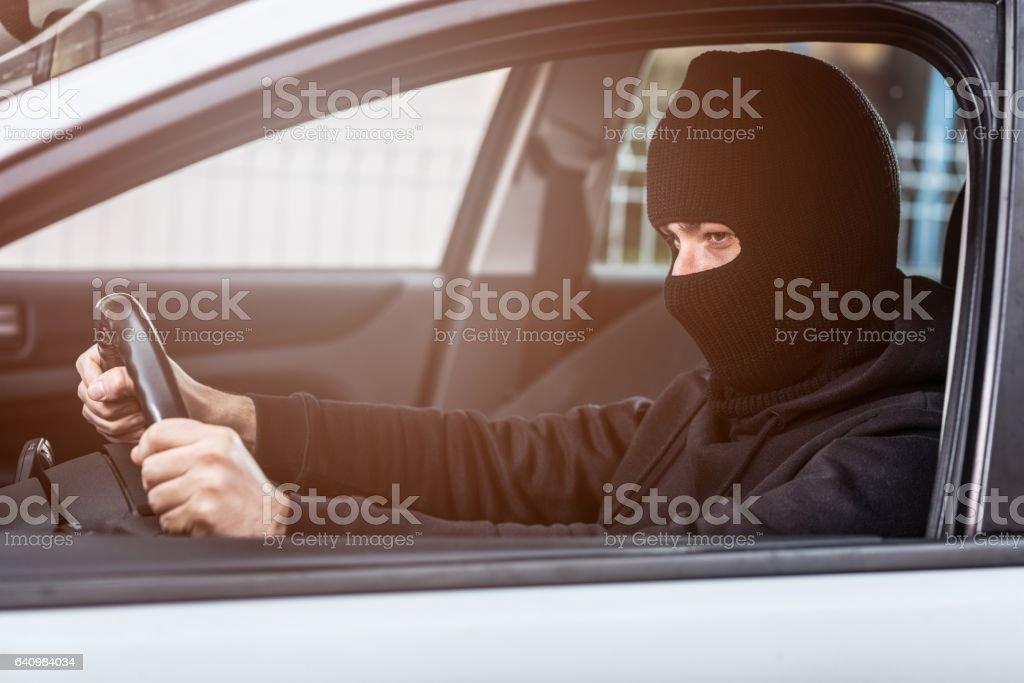 Auto thief driving a stolen car stock photo