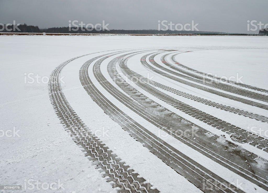 Auto tyre tracks in the snow stock photo