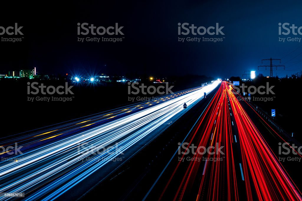 Autobahn at night stock photo