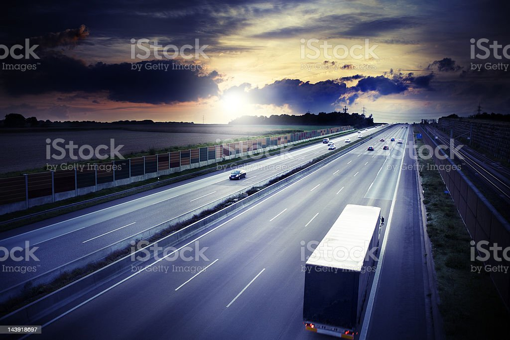 Autobahn - view from a bridge at dusk, dramatic sky stock photo