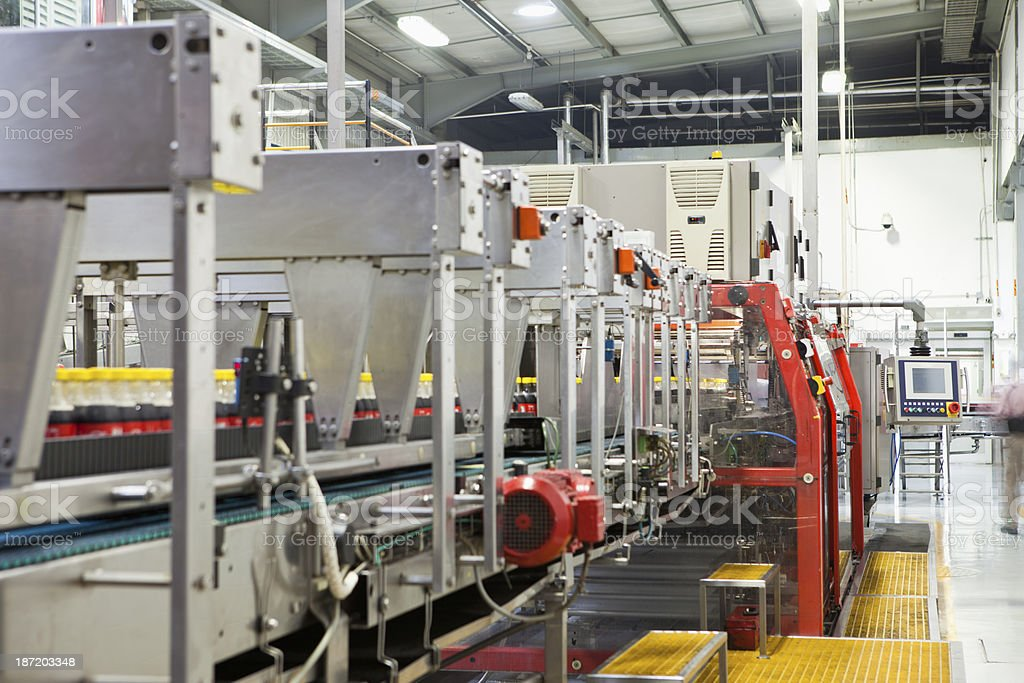 Automated assembly line at a bottling company stock photo