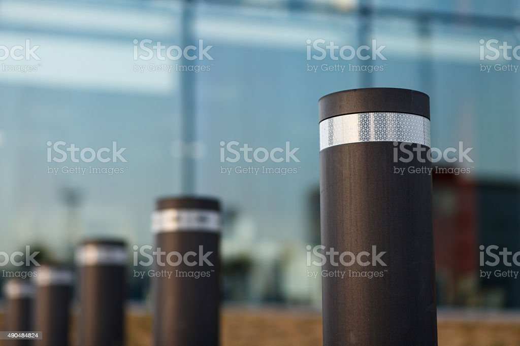Automated cylindrical road block stock photo