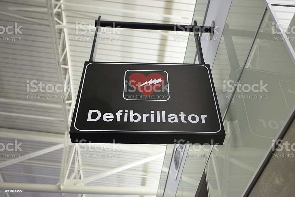 AED Automated External Defibrillator Emergency Sign Mounted on a Ceiling royalty-free stock photo