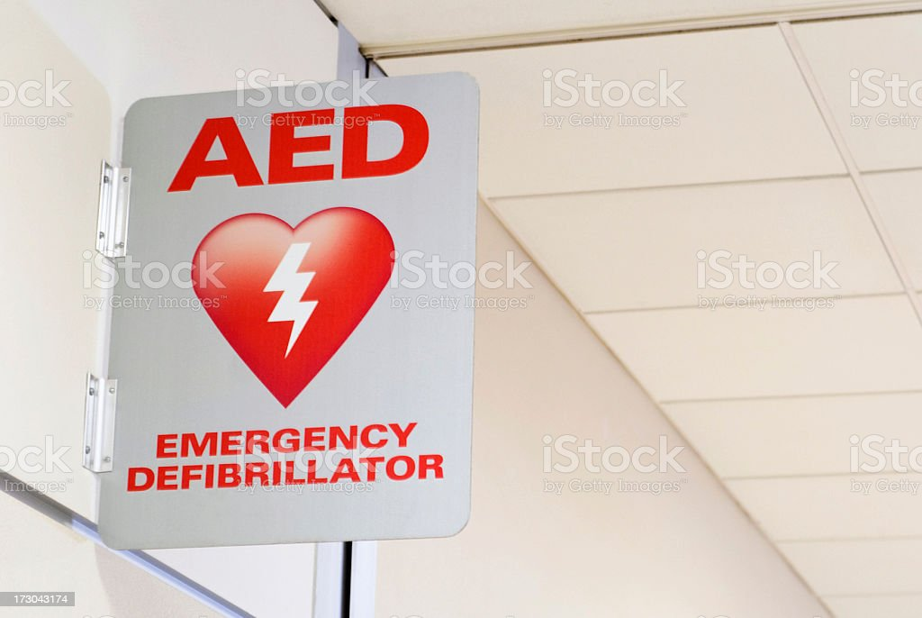 An emergency AED Automated External Defibrillator sign mounted to a...