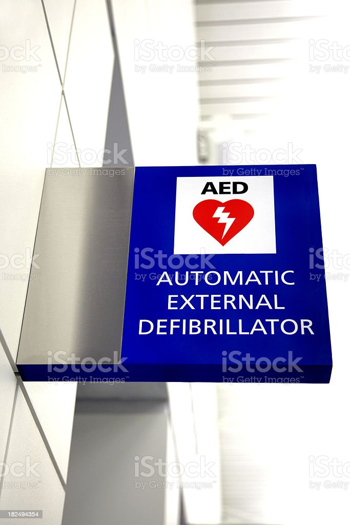 AED Automated External Defibrillator Emergency Sign Mounted on a Wall stock photo