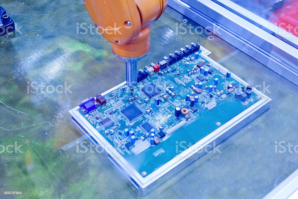automated machins of production printed circuit board stock photo