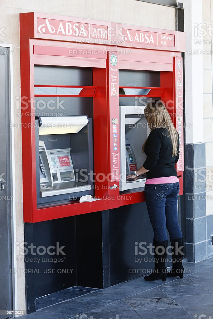 ABSA automated teller machine being used in Cape Town suburb stock photo