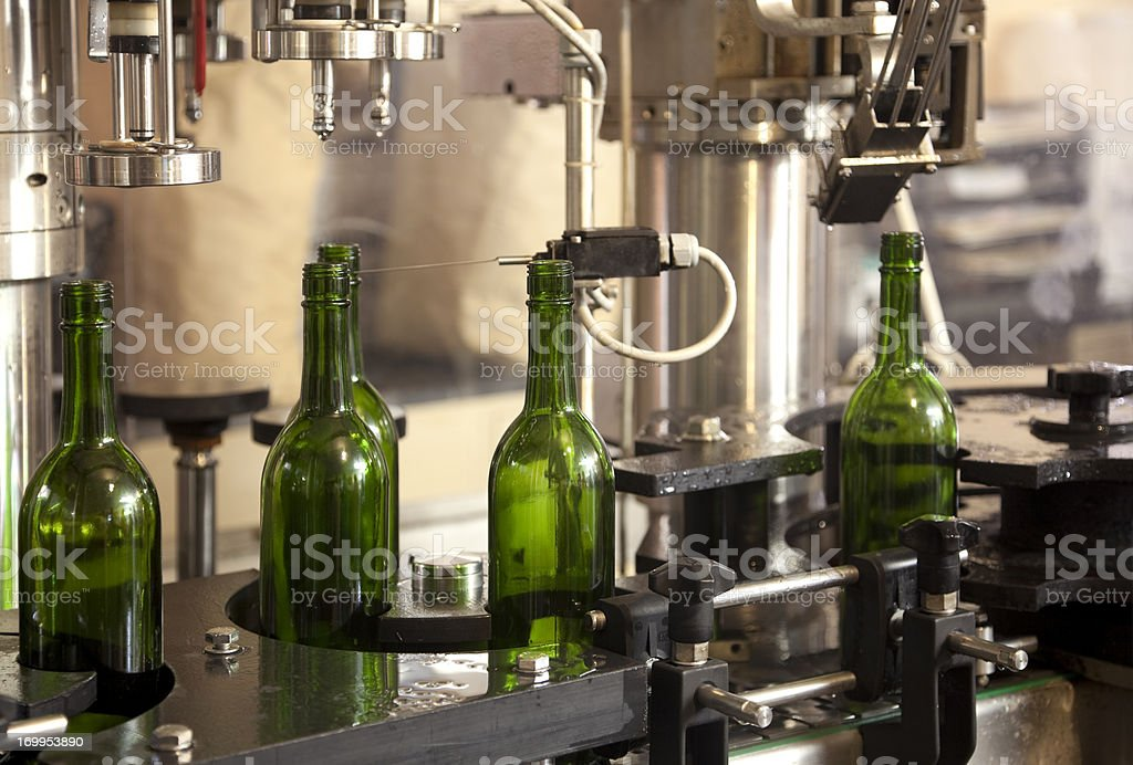 Automated Wine Bottling on Conveyor Belt in Factory royalty-free stock photo