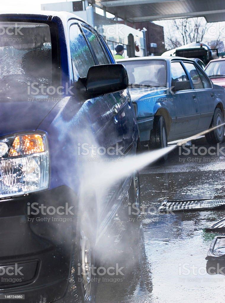 Automatic car wash washing a blue SUV  stock photo