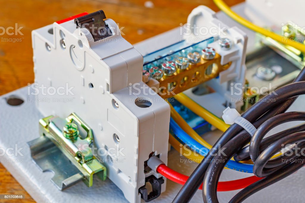 Automatic circuit breaker installed on a DIN-rail stock photo