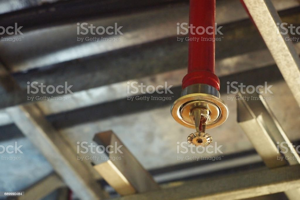 Automatic Fire ceiling Sprinkler in red water pipe System stock photo