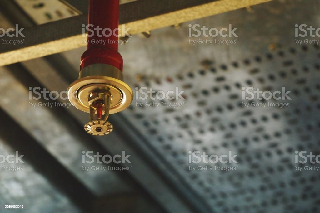 Automatic Fire Sprinkler in red water pipe System stock photo
