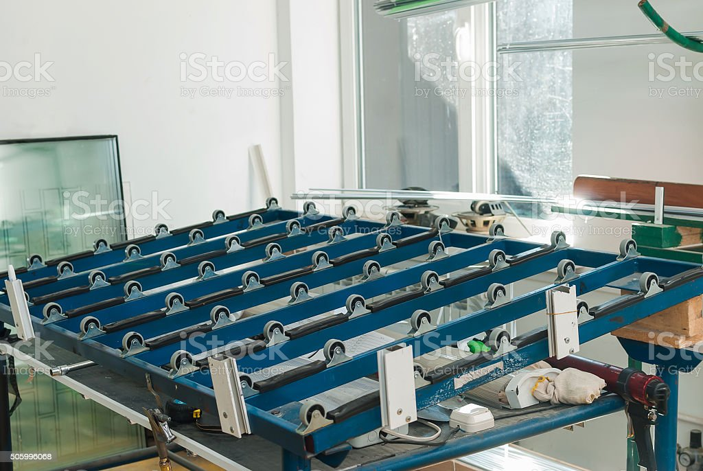 Automatic glass cutting table at PVC windows factory stock photo