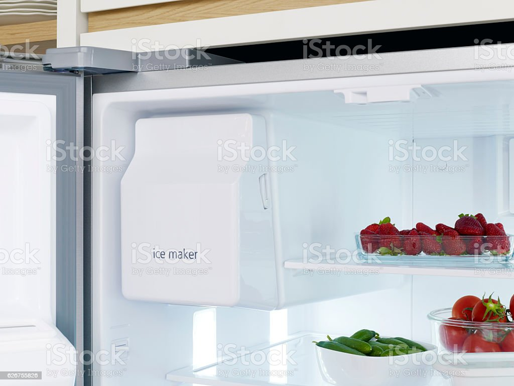 Automatic ice maker in refrigerator stock photo