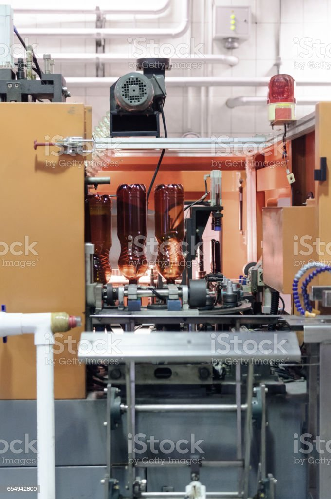 Automatic machine for blowing plastic PET bottles stock photo