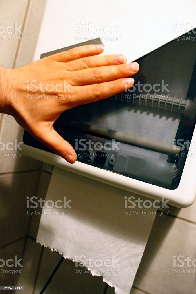 Automatic Paper Towel Dispenser working stock photo