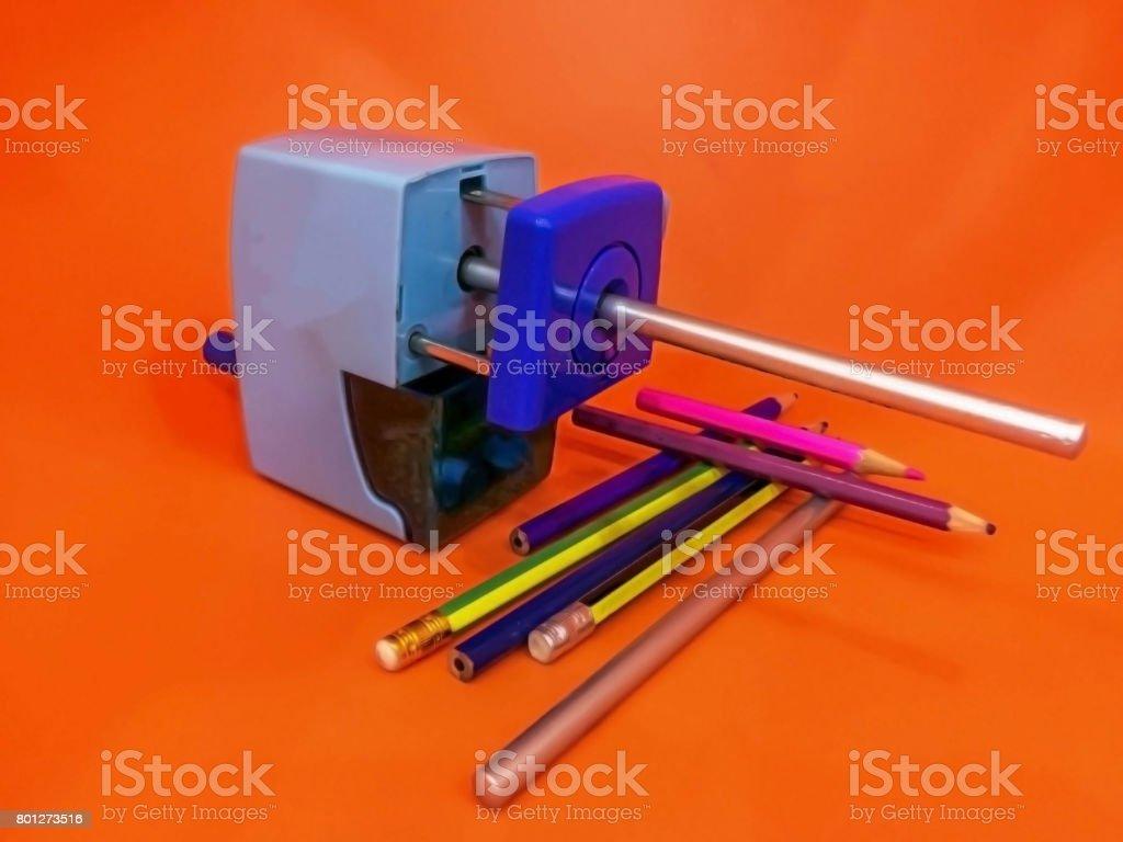 Automatic pencil sharpener with orange background stock photo