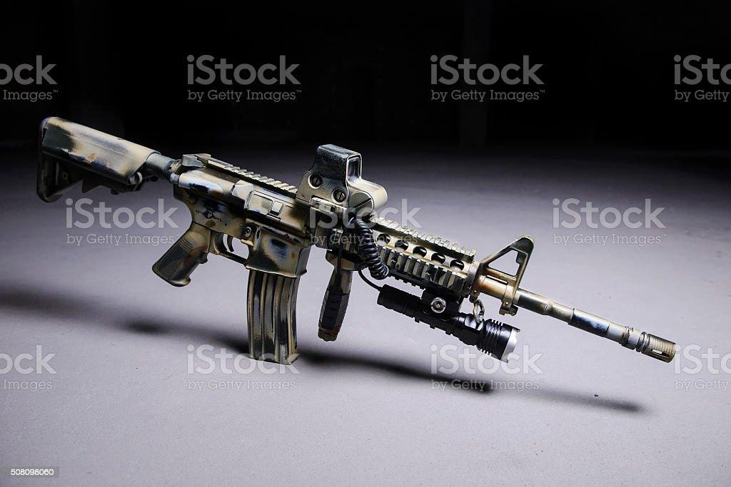 Automatic rifle M16 with LED flashlight stock photo