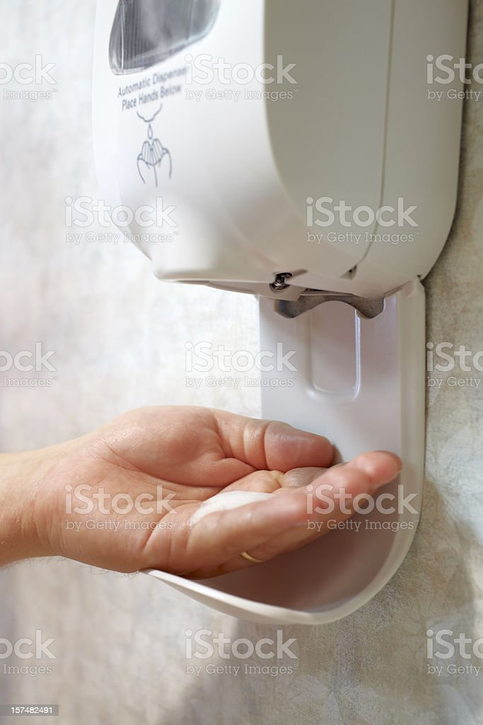 Automatic Sanitzer Dispenser with Male Hand and Soap stock photo