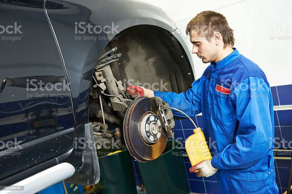 Automobile brake liquid replacing stock photo