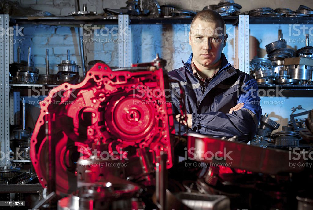 Automobile mechanic in gearbox repair shop royalty-free stock photo