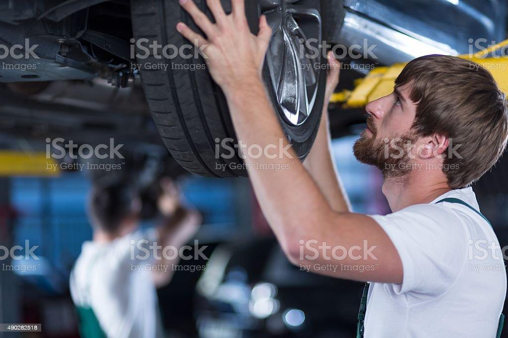 Automobile mechanics repairing a car stock photo