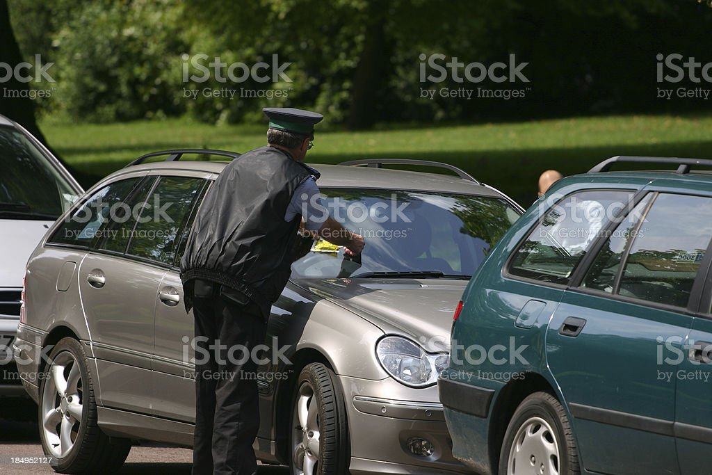 automobile parked receiving a ticket stock photo