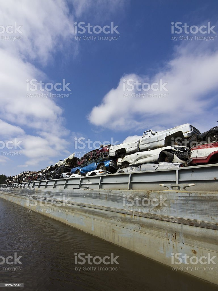 Automobile Recyling using barges royalty-free stock photo