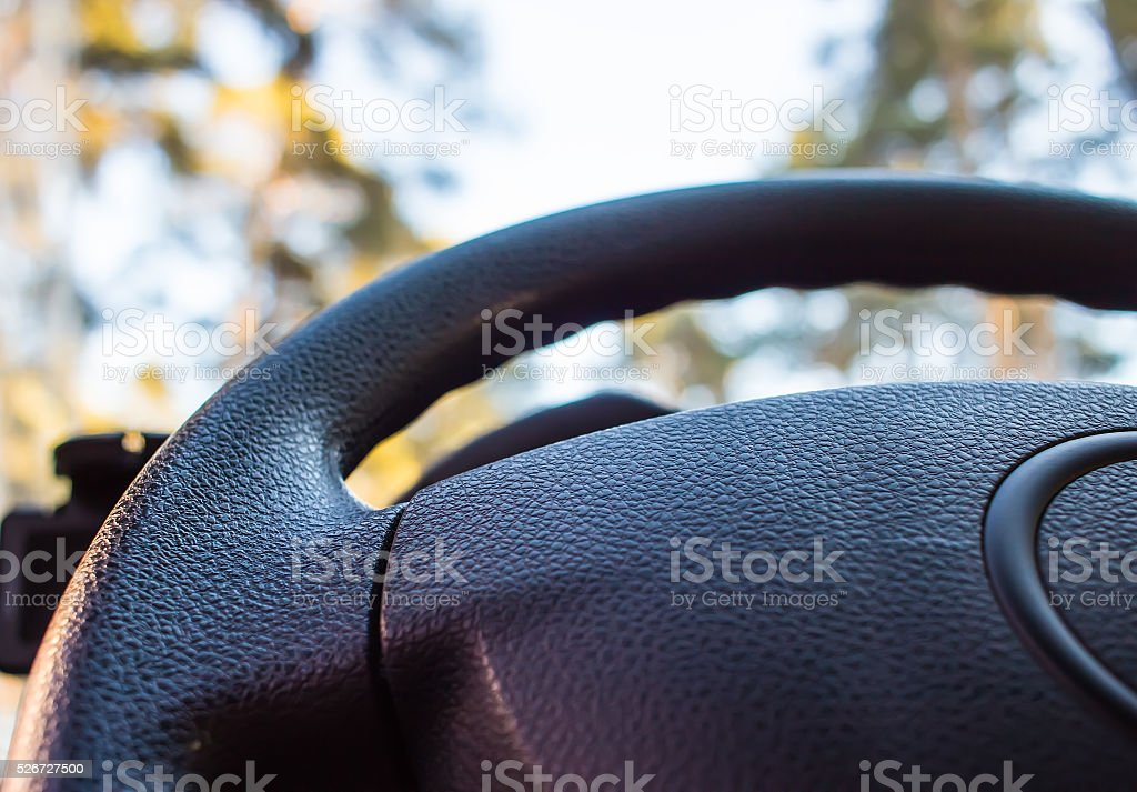 automobile steering wheel blur bottom view close up stock photo