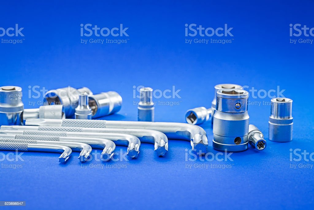 automobile torx and hexagonal keys on blue background close up stock photo