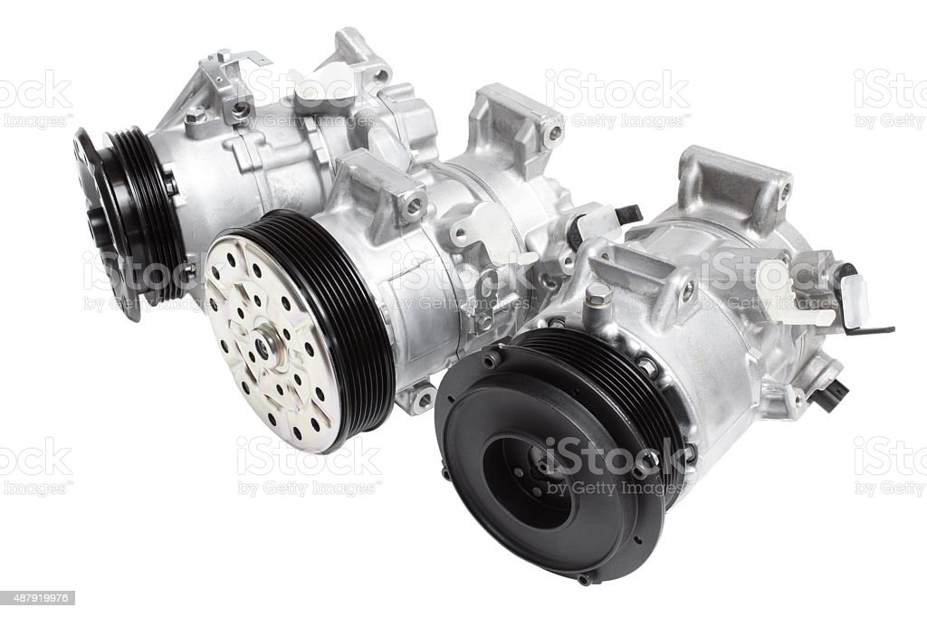 automotive air conditioning compressor on a white background. car parts stock photo