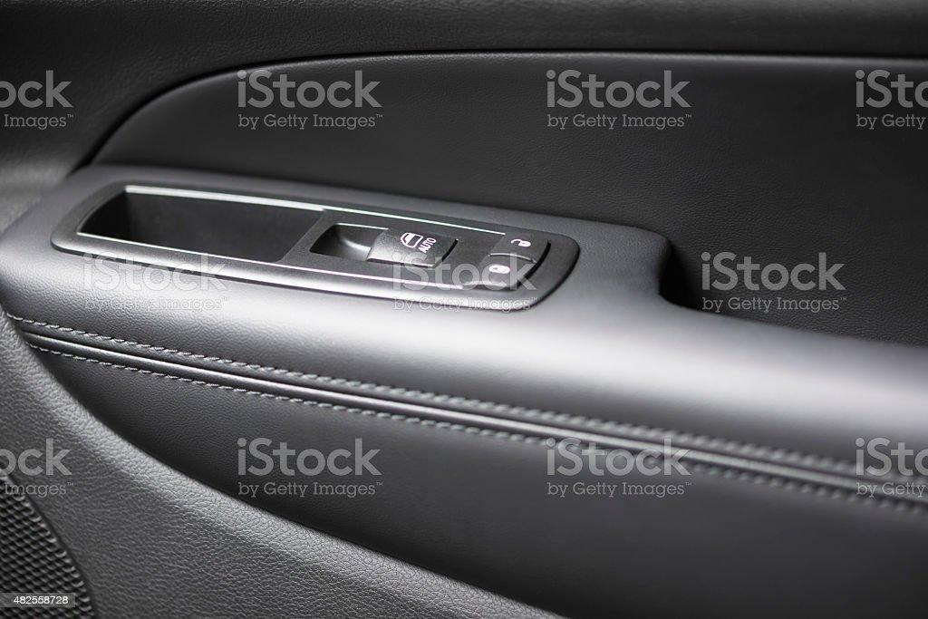 Car door panel with leather taken with macro lens.