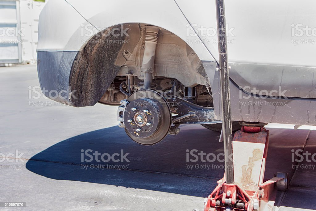 Automotive Concept: Car Wheel is Being Maintained on Professiona stock photo